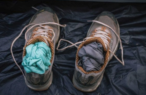 dry clothes in wet shoes camping trick