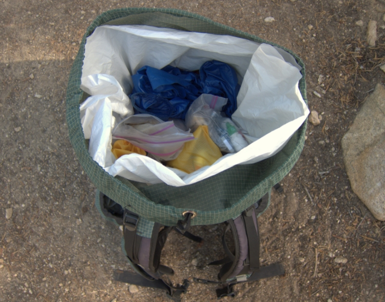 garbage bag liner in camp backpack
