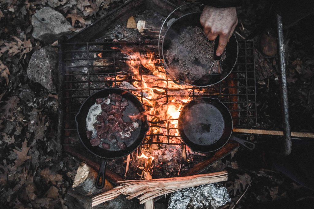 Hikers cooking over an open campfire