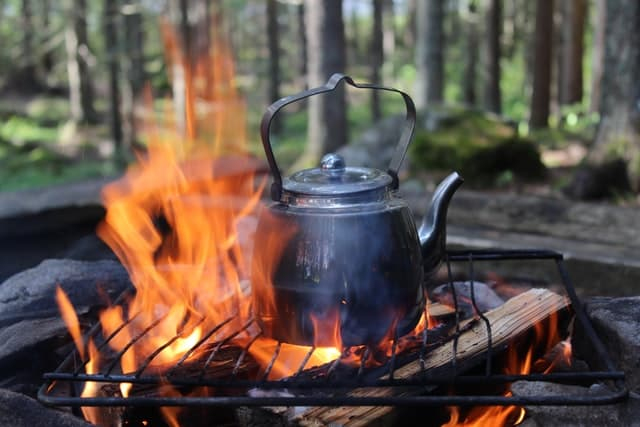 cooking over a campfire using firewood