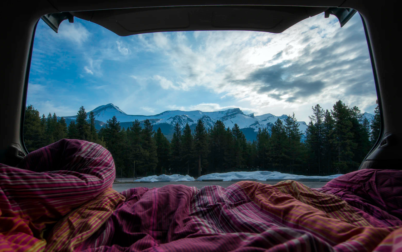 camping blanket in a tent overseeing the outdoors in the mountains