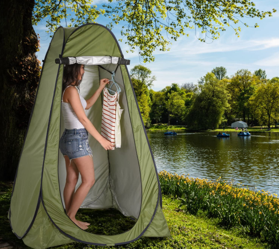 woman in a portable shower for camping