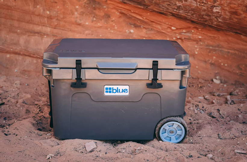 best camping cooler with wheels in dirt
